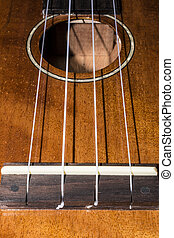 Ukulele Bridge and Sound Hole - Close up of bridge and sound...