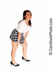 Teen girl bending down.