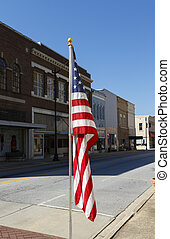 American Flag Displayed Along Main Street - An American Flag...