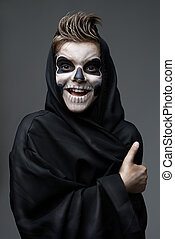 Teen with makeup skull showing thumbs up - Teen with makeup...