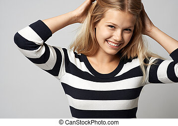 beautiful girl in a striped sweater cute smiling...