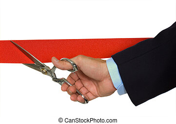 Hand cutting red ribbon