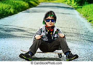freetime - Cool 7 year old boy with his skateboard on the...