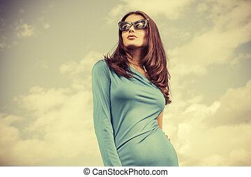 cloudy sky - Portrait of a charming lady in beautiful...