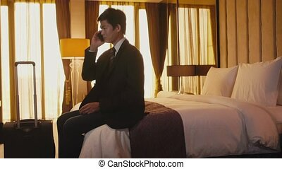 Manager in hotel room, travel