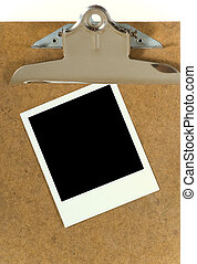 Polaroid on clipboard - Blank polaroid on clipboard includes...