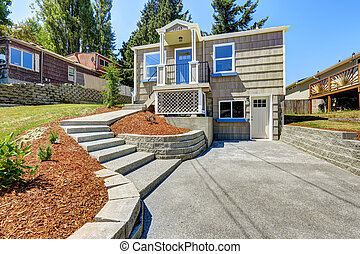 American house exterior with concrete walkway - Clapboard...