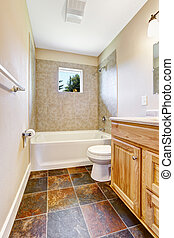 Empty bathroom with tile wall trim and window - Empty...