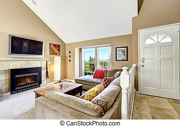 House interior with high vaulted ceiling. Living room with...