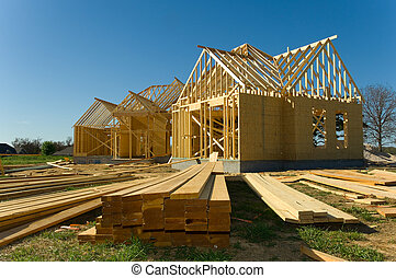 Construction industry - New home under construction with...