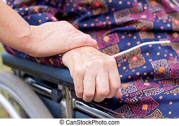 Elderly care - Handicapped elderly woman sitting in a...