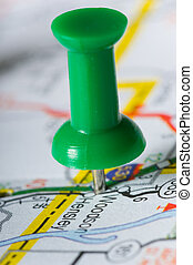 Pushpin on Map - Pushpin on map pinpointng a particular...