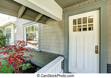 Entrance porch with white door