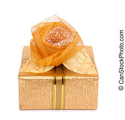 Beautiful gift box in gold paper with a silk rose isolated...