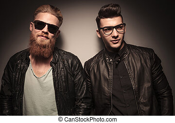 Two fashion guys in leather jacket