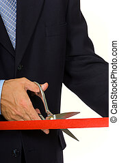 Man cutting red ribbon