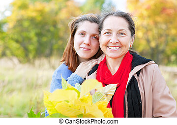 Happy  mature woman with adult daughter
