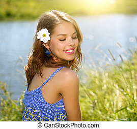 Beautiful girl relaxing outdoors countryside