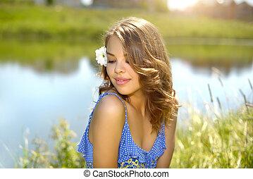 Beautiful girl relaxing outdoors. countryside