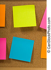 Sticky notes on a board - sticky notes or post-it notes on a...