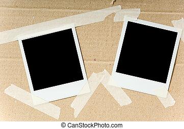 Polaroids on box