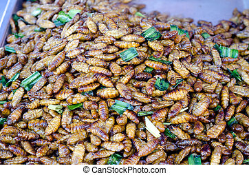 Fried silk worm for sale in a local market, thailand