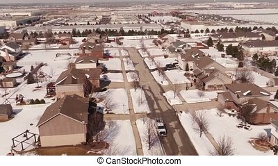 Aerial snow covered homes and yards - Overhead aerial view...
