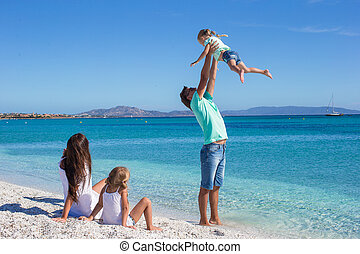 Family with two kids having fun during their tropical...