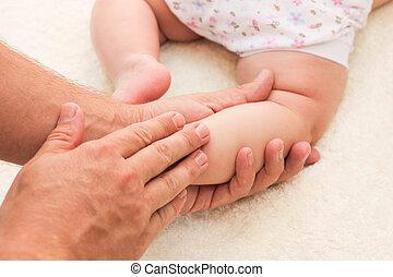 masseur doing massage little baby