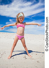 Adorable little girl in beautiful swimsuit have fun at...