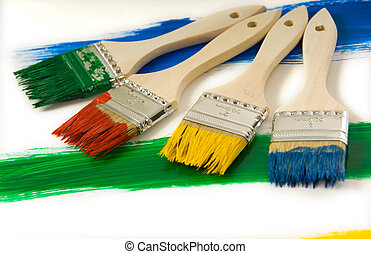 Colrful paintbrushes - Colorful paintbrushes on painted...
