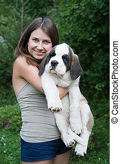 st Bernard - happy girl holding puppy St. Bernard