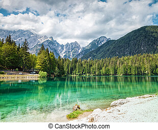 Lake Fusine in the Italian Alps - Lake Fusine with crystal...