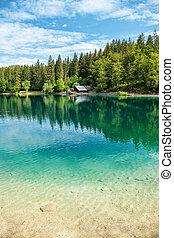 Lake Fusine in the Italian Alps - Lake Fusine with crystal...