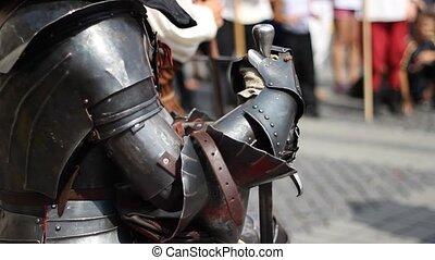 Knight in Steel Armor - Heavy armored knight in black steel...