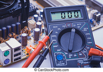 Close-up of multimeter on PCB plate - Close-up multimeter on...