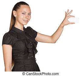 Woman holding small imaginary object with two fingers -...