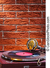Close up view on gramophone on background of the brickwall