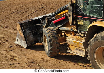 Side of a Backhoe - A side view of a large construction...