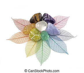 Healing Chakra Crystals on Leaves - Chakra colored crystals...