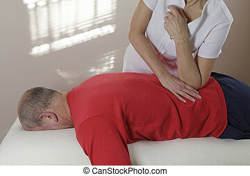 Applying pressure with elbow - Female sports massage...