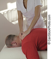 Working on trapezius muscle - Female sports massage...