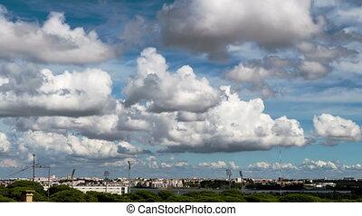 Beautiful Cumulus Clouds over Town