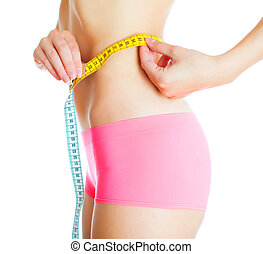 Weight loss concept. Woman measuring herself. Isolated on...