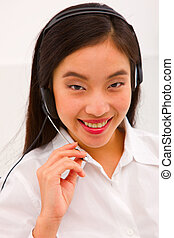Close-up of a smiling young woman with headset
