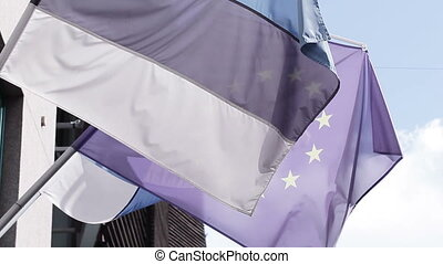 Flag of Estonia and EU - Between houses the flags of Estonia...