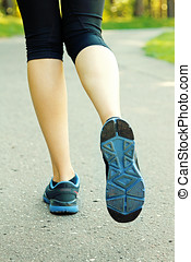 woman running on road, healthy lifestyle concept