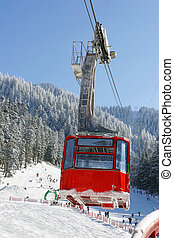Red cable car - Winter landscape with a red cable car