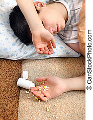 Teenager sleeps near the Pills - Teenager sleeps near the...