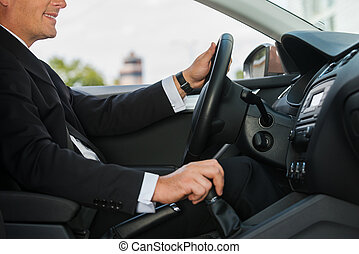 Driving with comfort Close-up of cheerful mature man in...